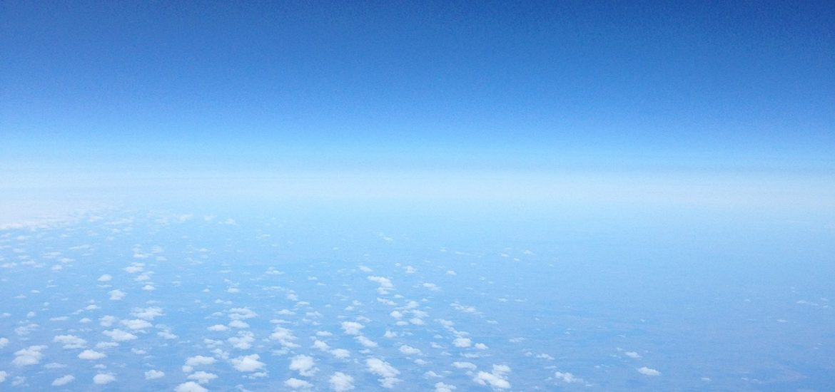View of spacious blue sky and clouds.